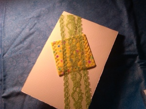 Cream card stock, quilted yellow pattern fabric, covered with green lace.