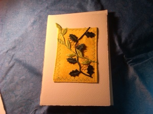 Again, yellow print fabric, sewn onto card and then light and dark green leaves hand-sewn onto the yellow.