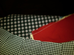 The small black and white checked is the exterior, the red is the lining, and the top black, white, and red checked is the contrast fabric for the handles and the band.