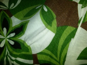 Green patterned stretch knit.