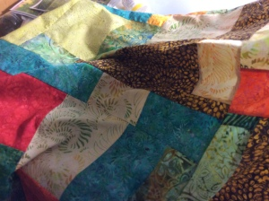 """These are Tonga Batiks from Timeless Treasures. The pattern is called """"Tonga Treats"""". I bought matching backing and a contrast binding. I like the contemporary look of these batiks."""