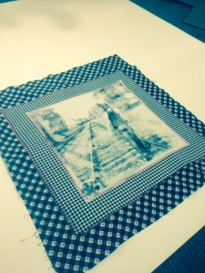 Photo hand-transferred to a vintage handkerchief, then sewn onto a contrast of black, red and white fabrics.